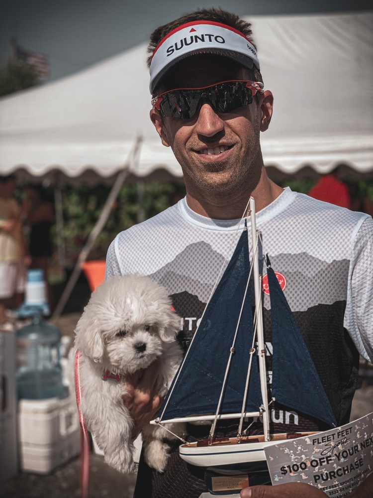 Winning the Diamond Lake Triathlon last year with my new puppy!